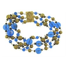 Vintage triple strand beaded Necklace with blue glass bead and metal gold tone beads