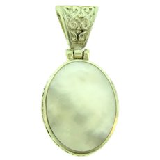 Marked 925 sterling silver framed Mother of Pearl Pendant