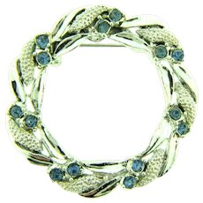 Signed Gerry's circular wreath Brooch with light blue rhinestones