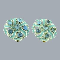 Signed ART large circular clip-on Earrings with light blue enamel and rhinestones