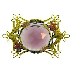 Vintage gold tone floral Brooch with large faceted purple glass cabochon and pink enamel flowers