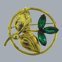 Vintage gold tone floral Brooch with emerald rhinestones