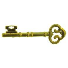 Vintage gold tone figural key Brooch