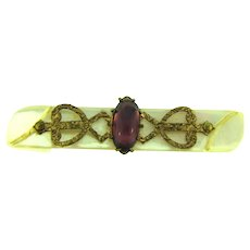 Vintage early Mother of Pearl Bar Pin with oval purple glass stone