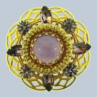 Vintage circular tiered Brooch with purple rhinestones and cabochon