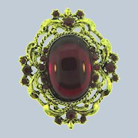 Vintage gold tone Brooch with red rhinestones and cabochon