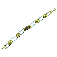 Vintage beaded link Bracelet with blue beads, pink and green rhinestones and a blue cabochon