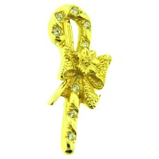 Vintage Christmas gold tone candy cane with bow Brooch
