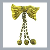 Vintage figural Bow Brooch with three chain bead dangles