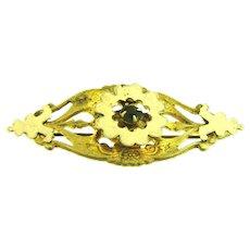 Vintage early gold tone Brooch with dark green rhinestone