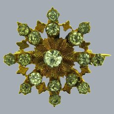 Vintage small snowflake shaped early Scatter Pin with paste stones