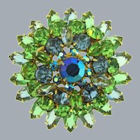 Vintage 1960's tiered round Brooch with green and blue rhinestones