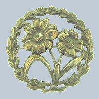Vintage silver tone circular repousse floral Brooch