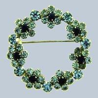 Vintage circular blue rhinestone floral Brooch