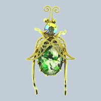Vintage gold tone winged bug Brooch with art glass cabochon body and rhinestone head