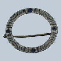 Marked Sterling silver circular early Scatter Pin with tiny blue paste stones