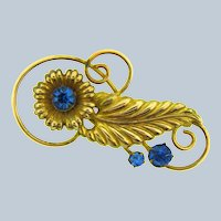 Marked 1/20 12 K gold filled floral Brooch with blue rhinestones