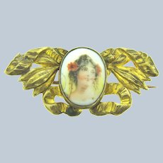 Vintage early gold tone small Brooch with painted porcelain center