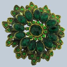 Vintage large gold tone layered Button with green rhinestones