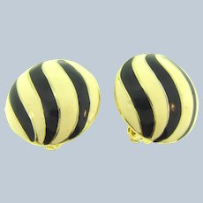 Signed Les Bernard large domed circular clip-on Earrings with black and cream enamel