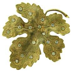 Vintage gold tone figural leaf Brooch with crystal rhinestones