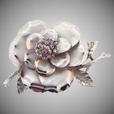 Signed ART large floral silver tone brooch
