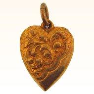 Gold tone puffy heart charm