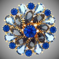 Lovely pin wheel design Brooch in shades of blue
