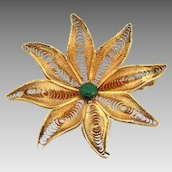 Simple floral design gold wash brooch with green composition bead center