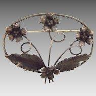 Marked sterling large oval open design floral brooch
