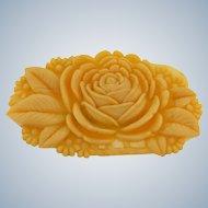 Marked Japan molded celluloid floral brooch