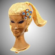 Signed Trifari China girl  figural gold tone Brooch