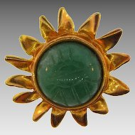 Egyptian themed figural Sun brooch with large hieroglyphic green cabochon