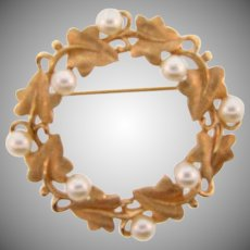 Signed Trifari circular vine design Brooch with imitation pearls