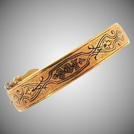 Early gold filled bracelet with Taille d'Epargne etched design