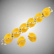Signed Lisner thermoset yellow Bracelet and matching clip on Earrings