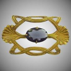 Vintage sash pin with center bluish purple glass stone