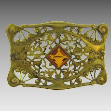 Victorian ornate Sash Pin with center amber glass stone