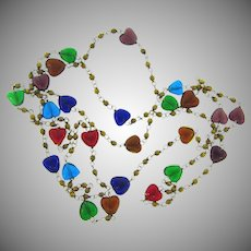Long necklace with multicolored glass bead hearts and gold tone bead spacers