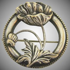 Vintage early circular Brooch with center floral design