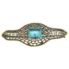 Small open filigree vermeil Brooch with blue glass center stone