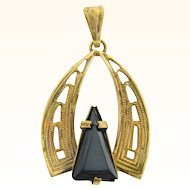 Unusual Egyptian themed gold tone pendant with hematite stone