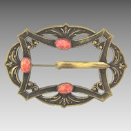 Large Victorian Sash Pin in a buckle design with mottled orange glass cabochons