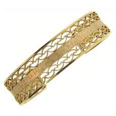 Vintage gold tone cuff Bracelet in a open filigree design