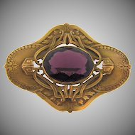 Lovely large Victorian Sash Pin ornate detailing and large deep purple faceted glass stone
