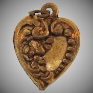 Tiny puffy heart Charm with floral repousse design