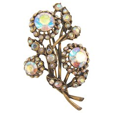 Signed Hollycraft floral Brooch in antiqued gold tone finish with AB rhinestones