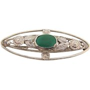 Marked Sterling oval floral Brooch with opaque green stone cabochon