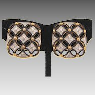 Signed Swarovski clip on gold tone earrings with crystal rhinestones and black enamel