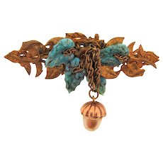 Signed Miriam Haskell unusual Bar  Brooch with molded glass turquoise leaves, gold tone leaves and a dangling acorn imitation pearl